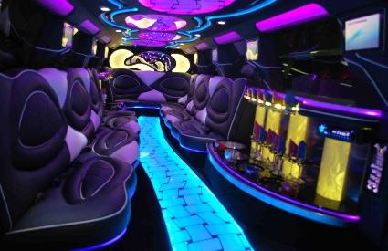 18-Passengers-Escalade-white-interior